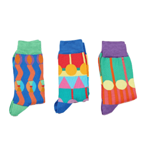 Semaine tastemaker Yinka Ilori wears patterned socks by Yinka Ilori