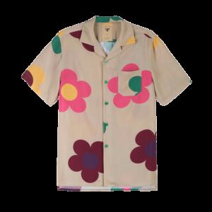Semaine tastemaker Yinka Ilori wears colorful daisy shirt by OAS