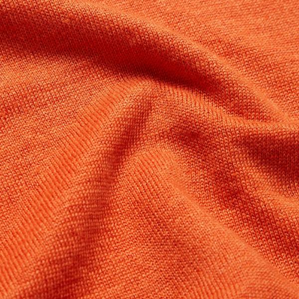 Semaine tastemaker Christiaan wears this orange linen sweater