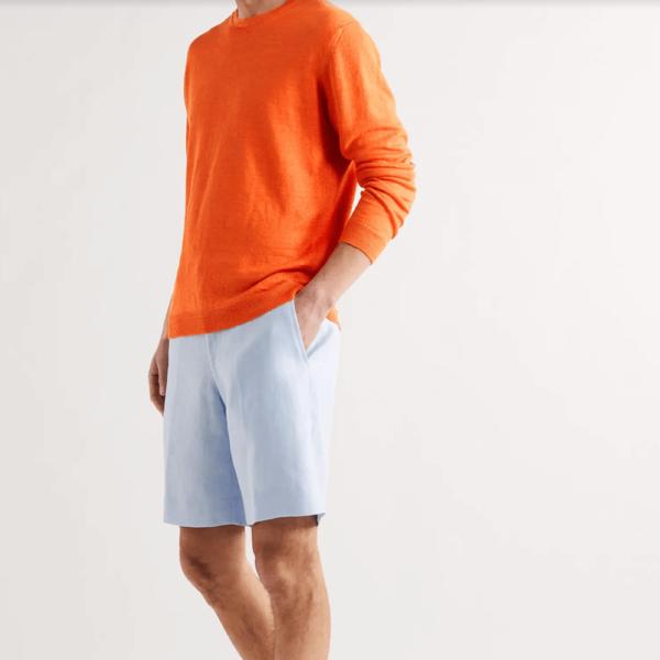 Semaine tastemaker Christiaan loves to wear this orange linen sweater